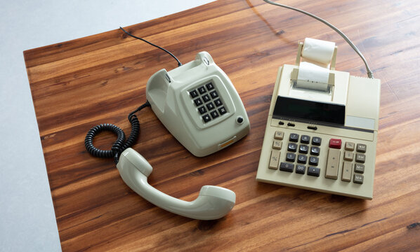 Old fashioned calculator and telephone
