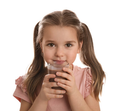 Cute little girl drinking chocolate milk on white background