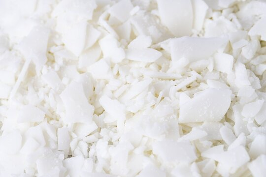 Full frame of white soy wax flakes for candle making