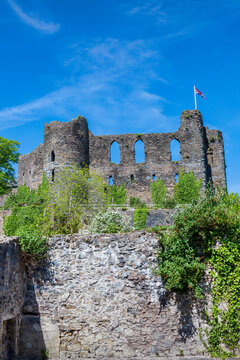 Laugharne Castle in Carmarthenshire south Wales UK which is an 12th century Norman fort ruin with and is a popular tourist travel destination landmark, stock photo image