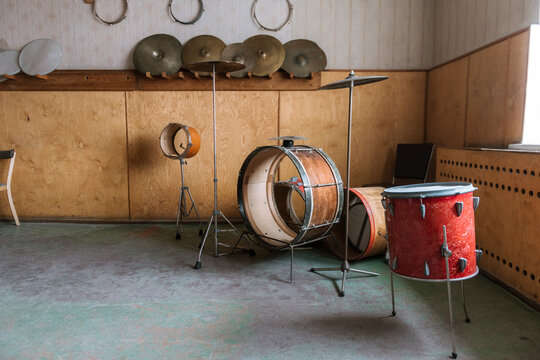 Abandoned and ruined drum kit and equipment in the Ghost Town of Pyramiden, Svalbard