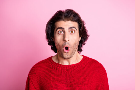 Portrait of young handsome shocked amazed surprised stunned man hear bad news isolated on pink color background