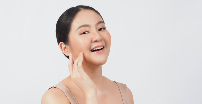 Beauty and skin concept. Young asian woman beauty face make up for skincare cosmetic and showing natural wellness soft and firm and ageless facial skin. younger-looking youthful. real acne no retouch