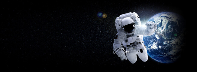 Fototapeta Astronaut spaceman do spacewalk while working for space station in outer space . Astronaut wear full spacesuit for space operation . Elements of this image furnished by NASA space astronaut photos.