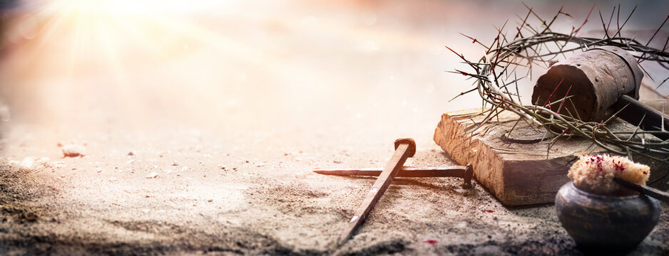 Passion Of Jesus Christ - Hammer And Bloody Nails And Crown Of Thorns On Arid Ground With Defocused Background