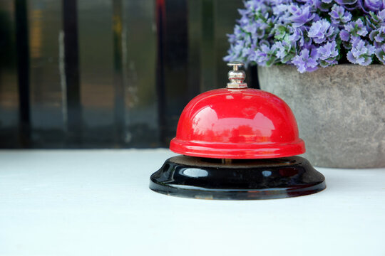 Desk bell push trigger ,reception bell on the white table couter.