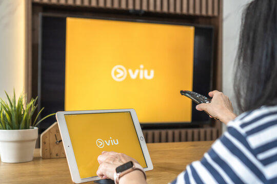 Bangkok-Thailand-February 25, 2021: Viu app logo, application for video, series, movie and film provider on ipad and home TV screen sharing