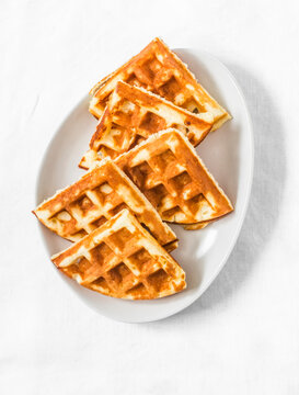 Cottage cheese waffles - delicious sweet dessert on a light background, top view