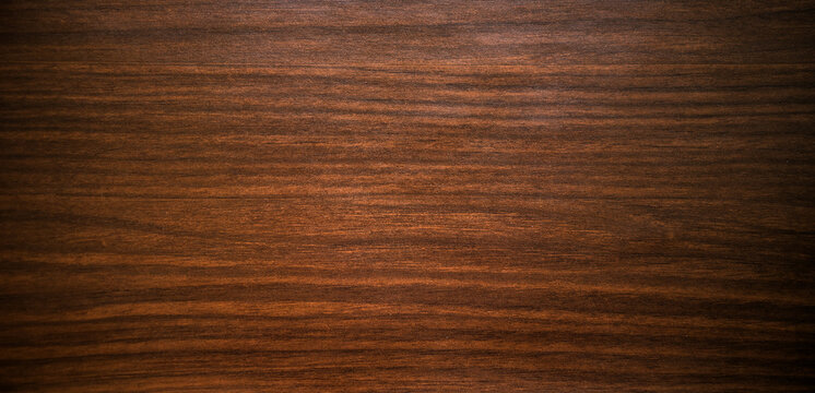 The texture of expensive vintage-colored mahogany