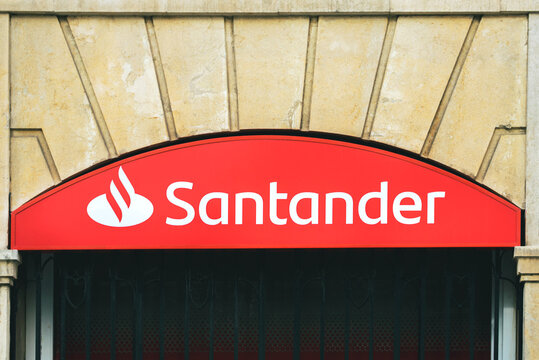 Santander Bank sign logo of branch office in the city.Exterior view of Santander bank branch