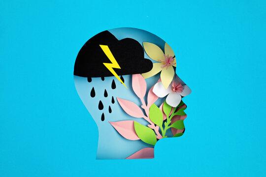 Papercut head, adult bipolar disorder concept. Mental health problems, psychology, mental illness