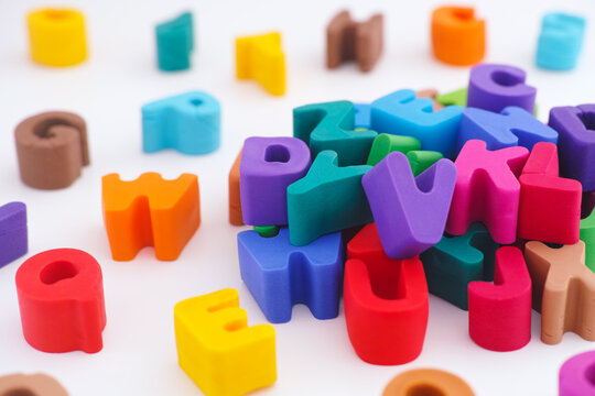 Colorful polymer clay letters in a pile