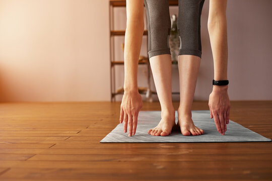 Close-up of young woman with exercise mat