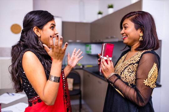 Deepavali or bhai Dooj festival - Indian young friends celebrating Diwali or Rakshabandhan Celebration at living room in home