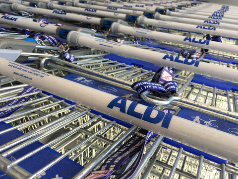 Aldi supermarket shopping carts.Aldi is German family-owned discount supermarket chains with over 10,000 stores in 20 countries and combined turnover of more than €50 billion.