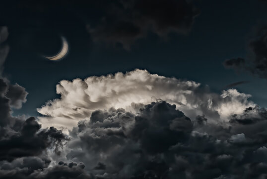 Crescent moon and clouds at night