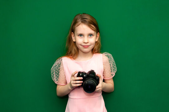 Child girl with a camera in her hands
