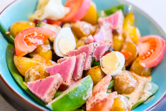 Close up image of fresh and tasty Nicoise salad with tuna fish