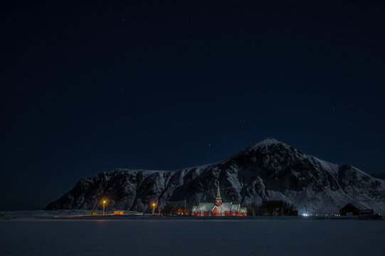 Local church in front of mountains at night, Flakstad, Nordland, Norway