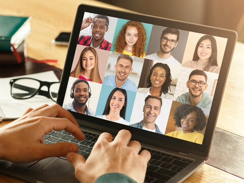 Unrecognizable Man Making Video Chat On Laptop With Diverse Multiethnic Colleagues