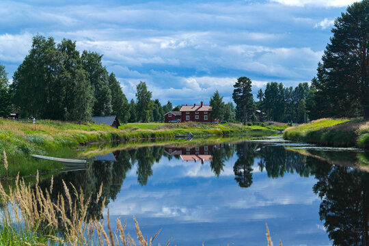 Landscape with a red house and a lake in Malung, Dalarna, Sweden