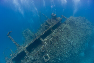 Underwater sunken ship wreck covered in coral