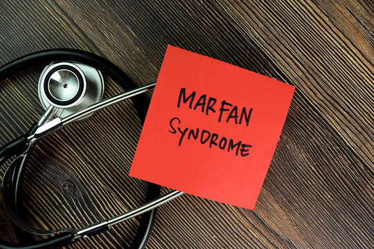 Marfan Syndrome write on sticky notes isolated on Wooden Table.
