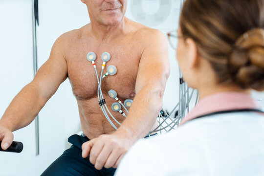 Doctor discussing with patient results of stress ECG