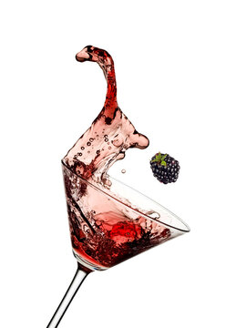 Red blackberry cocktail splash in a martini glass