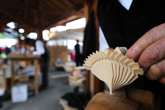 Old Domancy craft festival.  Wood carver.  France. 18.07.2016