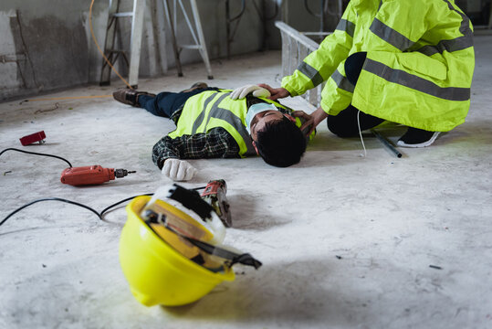 Work accidents of worker in the workplace at construction site area, Builder accident falls ladder on floor and Unconscious, Electric suction, Unsafe concept.