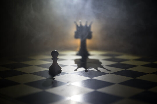 chess board game concept of business ideas and competition and strategy ideas concep. Chess figures on a dark background with smoke and fog and window with sunlight. Selective focus