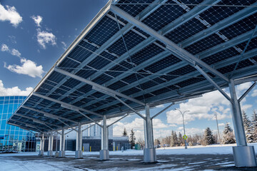 Fototapeta A modern solar carport for public vehicle parking is outfitted with solar panels producing renewable energy. obraz