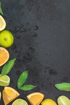Sliced fresh citrus fruits over black background