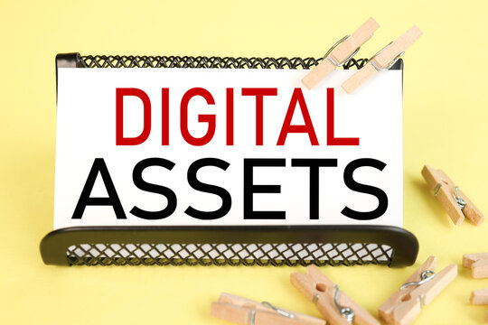 Digital Assets Business Management System Concept. Stop dreaming start doing. text on white paper on a yellow background