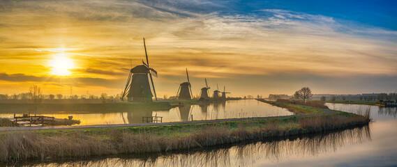 Obraz Rotterdam Netherlands, sunrise panorama nature landscape of Dutch Windmill at Kinderdijk Village - fototapety do salonu
