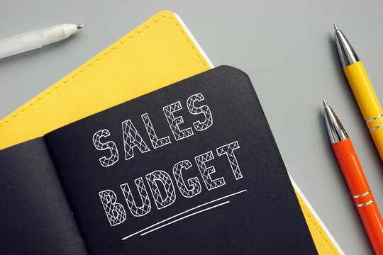 Business concept about SALES BUDGET with sign on the page. A financial plan, which shows how the resources should be allocated to achieve forecastedsales.