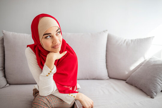 Portrait of a middle eastern woman smiling and wearing a hijab. Portrait of islamic woman smiling. Beautiful woman headshot looking at camera and wearing a hijab.