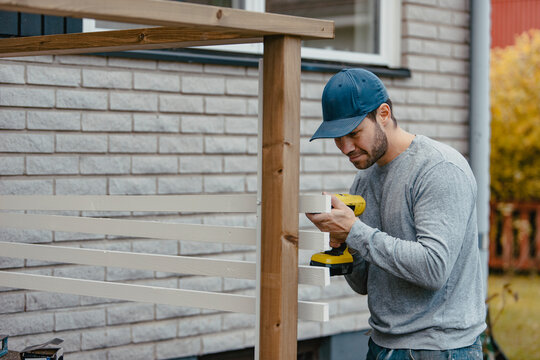 Carpenter building patio