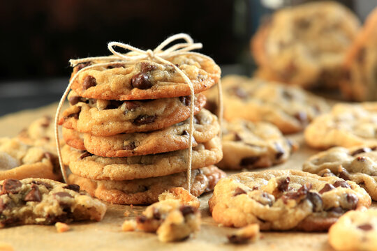 Stack of chocolate chip cookies on a baking sheet