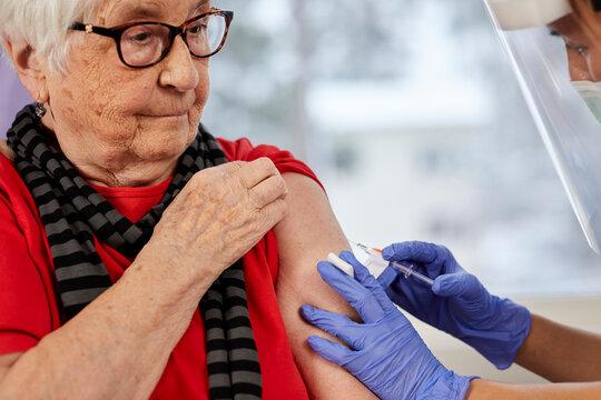 Senior woman getting covid vaccine