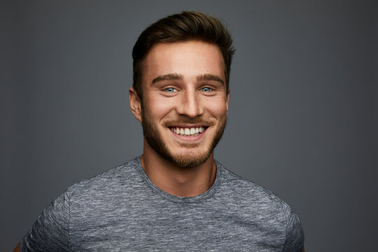 Studio shot of smiling young man