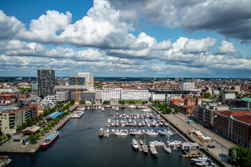 Antwerp, Belgium - July 12, 2019: Aerial view of Antwerp, Belgium, on a sunny summer day with beatiful clouds above the harbor.
