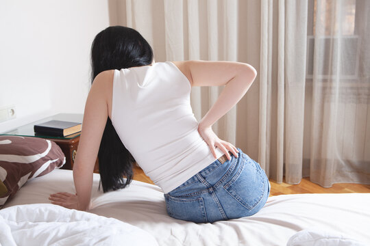 a young girl's back hurts.