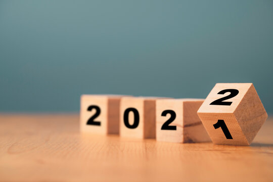 Flipping of wooden cube block for change 2021 to 2022 year , Preparation for merry Christmas and happy new year concept.