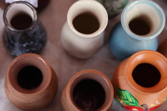 Brown whitw and blue clay jars top view, modern Russian traditional pottery production