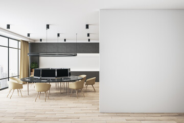 Light empty wall with copyspace for your logo in modern spacious coworking office with designed...