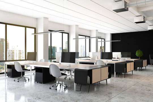 Open space office with modern wooden furniture, computers on tables, glossy floor and big window with city view