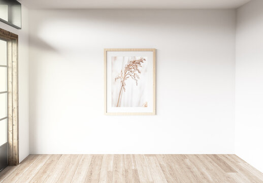 Wooden Frame Mockup Hanging on the Wall of a Bright Room