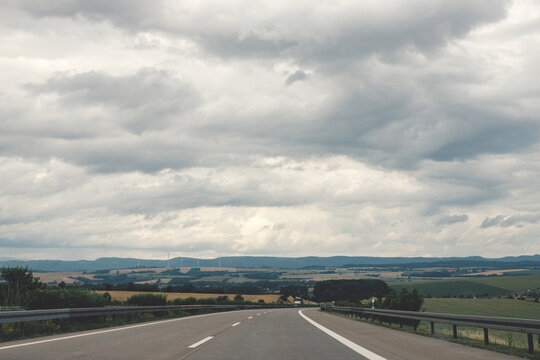 Empty road on a cloudy day. Traveling close to home by car. European autobahns